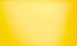 与聚光灯的抽象黄色背景 免版税图库摄影