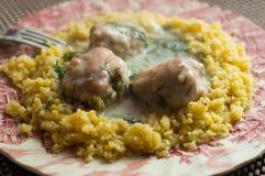 与肉丸和沙粒的晚餐 免版税库存图片
