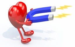 与胳膊、腿和磁铁的心脏在手上 免版税库存照片