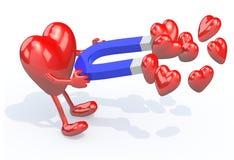 与胳膊、腿和磁铁的心脏在手上 免版税图库摄影