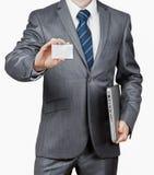 与膝上型计算机和名片的商人 免版税库存照片