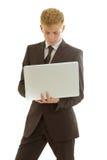 与膝上型计算机的商人 免版税图库摄影