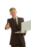 与膝上型计算机的商人 库存图片