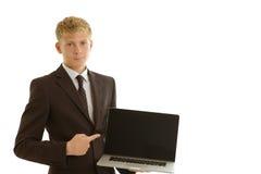 与膝上型计算机的商人 免版税库存照片
