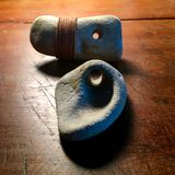 与自然孔的两块石头 库存图片