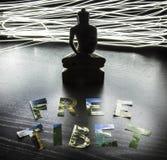 与自由西藏信件的菩萨雕象 库存图片