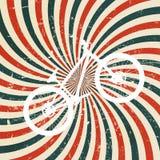 与自行车的抽象催眠减速火箭的背景。 免版税库存图片