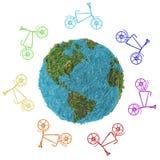 与自行车的抽象地球在白色背景 免版税库存照片