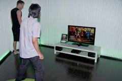 与舞蹈中央的Xbox 360和Kinect 免版税库存图片