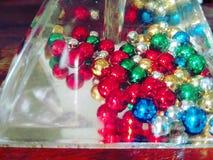 与色的珍珠的一个原始的透明对象 图库摄影