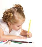 与色的铅笔的小女孩图画 库存照片
