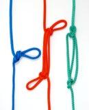 与色的绳索的结 免版税库存图片