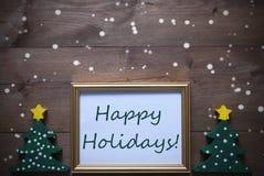 与节日快乐圣诞树和文本的框架,雪花 图库摄影