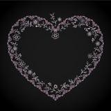 与花卉元素的装饰心脏设计 库存照片