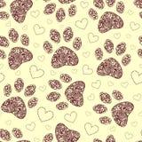 与花卉动物爪子打印的无缝的模式 库存照片