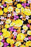 与花卉样式的五颜六色的蜡染布织品纹理 图库摄影