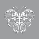 与花卉样式的白皮书蝴蝶在灰色 免版税库存图片