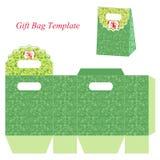 与花卉样式的绿色礼物袋子模板 库存照片