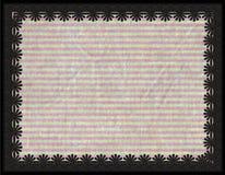 与花和条纹背景的金属框架 免版税图库摄影