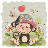 与花和蝴蝶的猴子 图库摄影