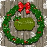 与花圈的圣诞卡。 免版税库存图片