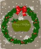 与花圈的圣诞卡。 免版税库存照片