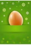 与花的一个美味的复活节彩蛋 免版税库存照片
