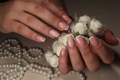 与花的柔和的法式修剪设计 库存照片