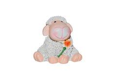 与花的玩具羊羔 免版税库存图片