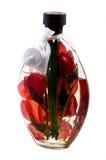 与花的芳香油蜡烛 免版税库存照片