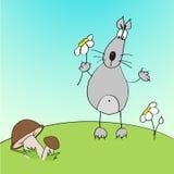 与花的逗人喜爱的狼在草甸 免版税库存图片