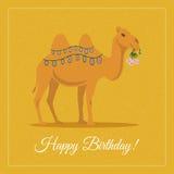 与花的骆驼 免版税库存照片