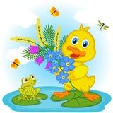 与花的鸭子 免版税图库摄影