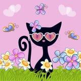与花的黑小猫 库存照片