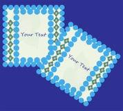 与花饰的两个与螺旋线的框架和球在蓝色背景 皇族释放例证