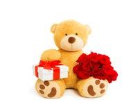 与英国兰开斯特家族族徽礼物盒和花束的玩具熊  库存图片
