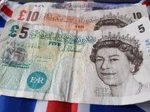 与英国国旗英国旗子的金钱 库存照片