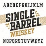 与范例设计的唯一桶威士忌酒标签字体 免版税库存照片