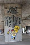 与荷马辛普森的街道画,创造由Legia华沙橄榄球俱乐部爱好者  库存照片