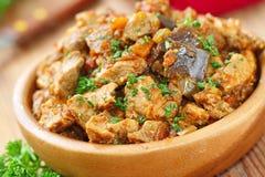 与菜和香料的肉炖煮的食物 库存照片