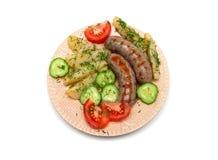 与菜的开胃烤香肠在板材 免版税库存照片