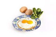 与菜的早餐鸡蛋 免版税库存照片