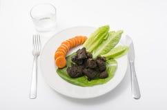 与菜的食家粪 免版税库存照片
