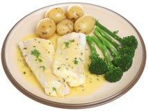 与菜被隔绝的板材的被烘烤的黑线鳕 免版税库存照片