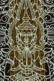 与菩萨样式的格栅在柬埔寨王国发现了有金黄bokeh背景 库存图片