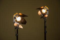 与菲涅耳透镜的两盏卤素聚光灯 免版税库存照片