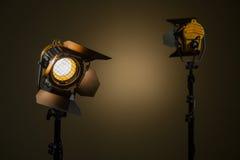 与菲涅耳透镜的两盏卤素聚光灯 库存照片