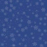 与落的雪花的圣诞节蓝色背景 库存照片