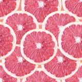 与葡萄柚切片的无缝的背景 库存图片