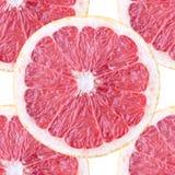与葡萄柚切片的无缝的背景 免版税库存图片